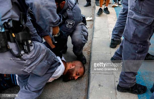 Israeli security forces detain Palestinian Christian activist Nidal Abboud wearing a tshirt showing the logo of the Christian National Gathering in...