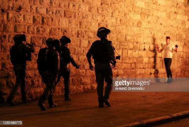 Israeli security forces disperse Palestinian protesters outside the Damascus Gate in Jerusalem's Old City on April 23 amid mounting tensions over a...