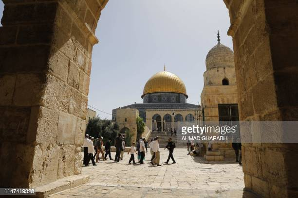 Israeli security forces escort a group of Jewish settlers visiting the AlAqsa Mosque compound revered as the site of two ancient Jewish temples and...