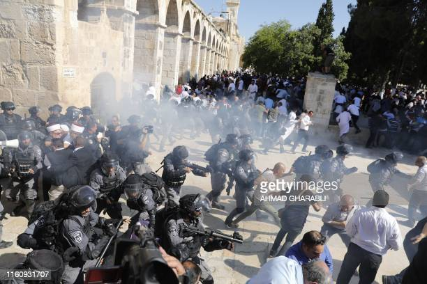 TOPSHOT Israeli security forces fire sound grenades inside the AlAqsa Mosque compound in the Old City of Jerusalem on August 11 as clashes broke out...