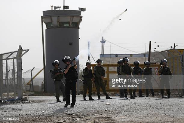 Israeli security forces fire tear gas canisters during clashes with students from Palestinian universities outside the compound of the Israeli Ofer...