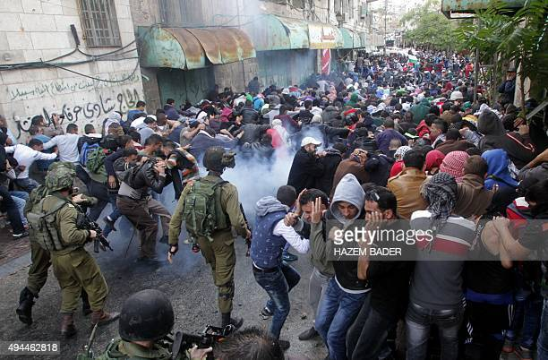 Israeli security forces fire tear gas canisters to disperse Palestinian protesters during a demonstration in the occupied West Bank city of Hebron on...