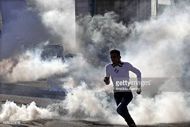 Israeli security forces fire tear gas to Palestinian demonstrators who protest killing of Sadi Urfe by Israeli forces in Hebron West Bank on November...