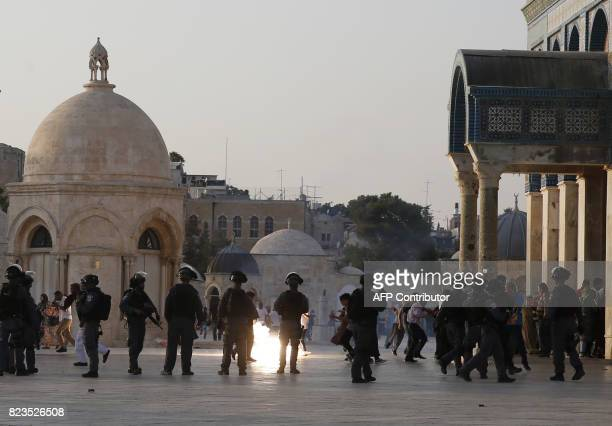 TOPSHOT Israeli security forces fire teargas to disperse Palestinians after clashes broke out inside AlAqsa mosque's compound in Jerusalem's Old City...