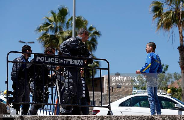 Israeli security forces frisk a Palestinian youth at Damascus Gate a main entrance to Jerusalem's Old City on April 1 2016 / AFP / AHMAD GHARABLI