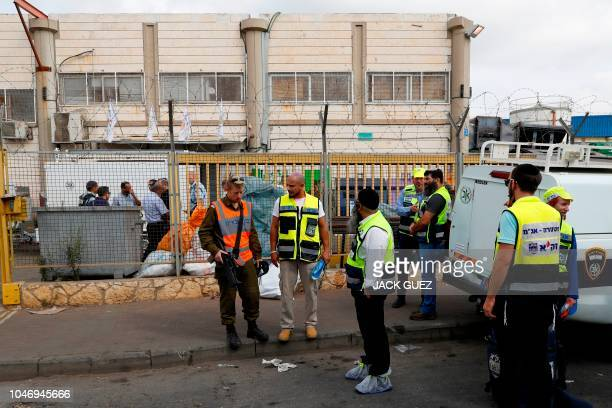 Israeli security forces gather at the site of a reported attack at the Barkan Industrial Park near the Israeli settlement of Ariel in the occupied...