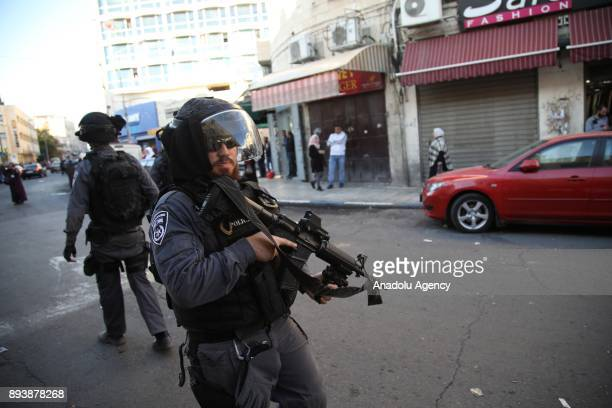 Israeli security forces intervene demonstrators during a protest against US President Donald Trumps announcement to recognize Jerusalem as the...