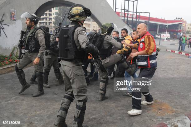 Israeli security forces intervene health team members after they demanded the release of a protester who was taken into custody by Israeli soldiers...