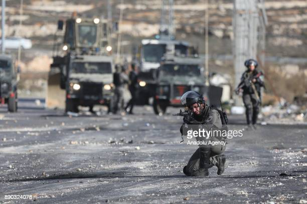 Israeli security forces intervene in a demonstration against US President Donald Trump's recognition of Jerusalem as Israel's capital near Beit El...