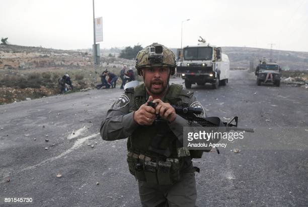 Israeli security forces intervene in a demonstration against US President Donald Trump's recognition of Jerusalem as Israel's capital as Israeli...