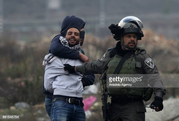 Israeli security forces intervene in a demonstration against US President Donald Trump's recognition of Jerusalem as Israel's capital as an Israeli...