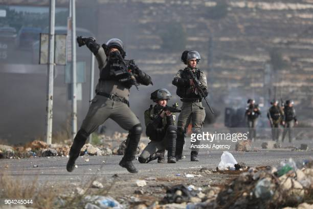 Israeli security forces intervene in a protest against US decision to recognize Jerusalem as Israel's capital near Beit El Checkpoint in Ramallah...