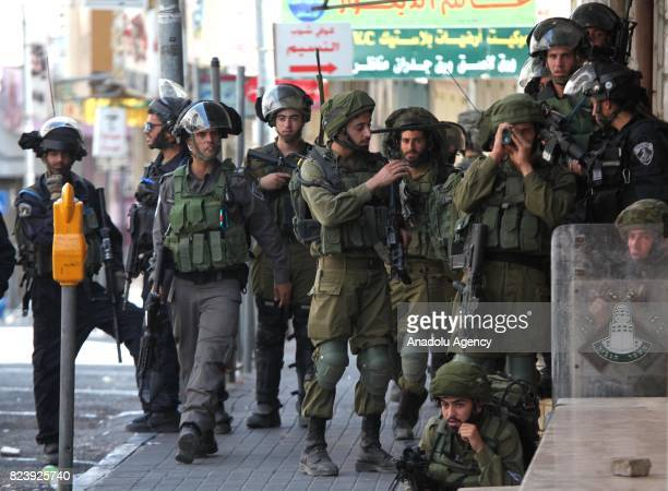 Israeli security forces intervene in Palestinian demonstrators with tear gas bombs and plastic bullets during a protest against Israeli violations...
