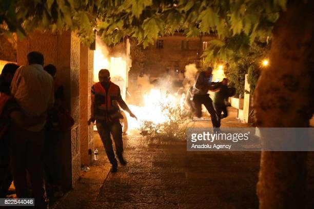 Israeli security forces intervene in Palestinians with plastic bullets stun grenades and tears gas after Palestinians performed evening prayer in...