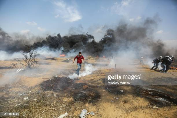 Israeli security forces intervene Palestinian protest with tear gas during Great March of Return at GazaIsrael border in Khan Yunis Gaza on April 27...