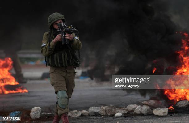 Israeli security forces intervene Palestinian protesters during a protest against US President Donald Trumps announcement to recognize Jerusalem as...