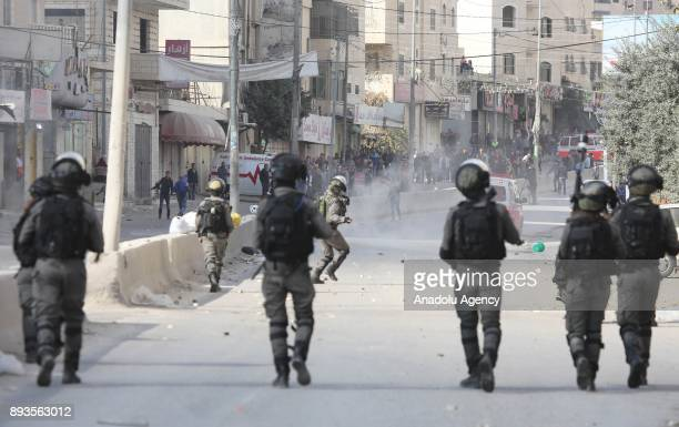 Israeli security forces intervene Palestinians as they gather to stage a protest against US President Donald Trumps announcement to recognize...