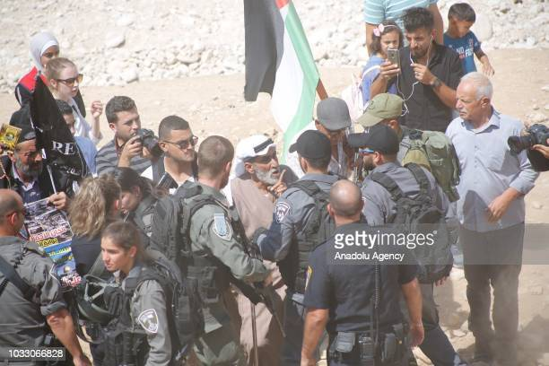 Israeli security forces intervene Palestinians as they stage a protest against the blockade on Khan al-Ahmar region, populated by Palestinian...