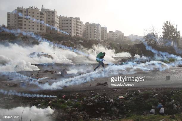 Israeli security forces intervene Palestinians with tear gas during a protest against US President Donald Trumps announcement to recognize Jerusalem...