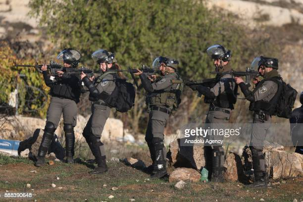 Israeli security forces intervene protesters during a demonstration against US President Donald Trump's recognition of Jerusalem as Israel's capital...