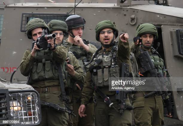 Israeli security forces intervene protesters during a protest against US President Donald Trumps announcement to recognize Jerusalem as the capital...