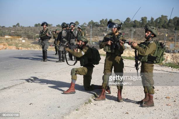 Israeli security forces intervene protestors during a demonstration to protest against US decision to recognize Jerusalem as Israel's capital and to...