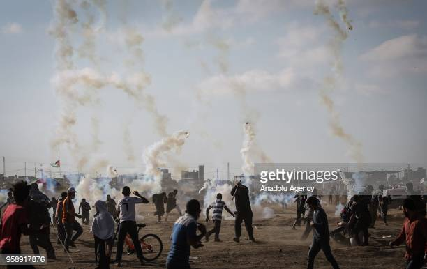 Israeli security forces intervene to Palestinian demonstrators with tear gas during a protest organized to mark 70th anniversary of Nakba also known...