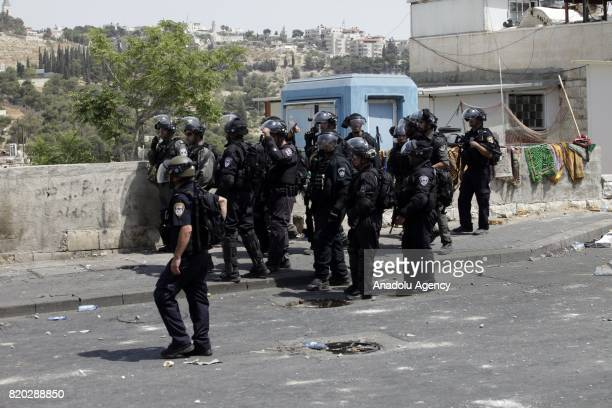 Israeli security forces intervene to Palestinian protesters during a demonstration to protest metal detectors installed by Israeli authorities to...