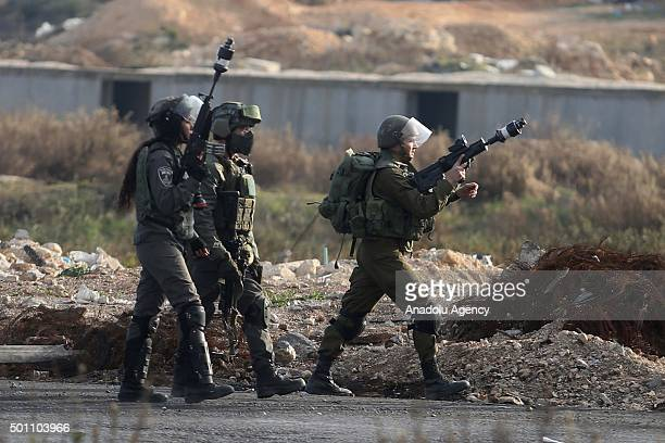 Israeli security forces intervene to Palestinian protesters during clashes between Palestinians and Israeli security forces at Beitel checkpoint in...