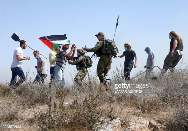 Israeli security forces intevene qs Palestinians protesting against Jewish settlements and the normalisation of ties with two Arab states, scuffle...