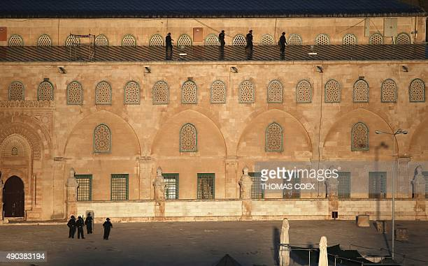 Israeli security forces keep position on the roof and around the alAqsa mosque in Jerusalem's old city during clashes with Palestinians on September...
