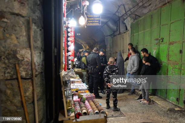 Israeli security forces officers checking IDs inside the Old City of Jerusalem following a suspected shooting attack near the entrance to the...