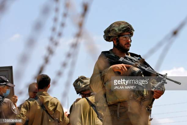 Israeli security forces patrol along the security fence in the village of Muqeibila near the West Bank town of Jenin on September 6 following the...