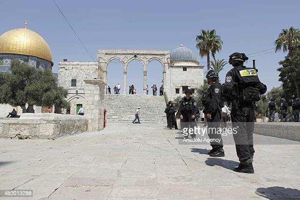 Israeli security forces patrol while Palestinians protest against Jewish settlers stormed AlAqsa mosque compound in the old city of Jerusalem on July...
