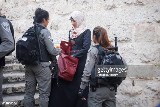 Israeli security forces perform an identity check and search purses of Palestinian outside the Lion's Gate at Al Aqsa Mosque who refuse to enter...