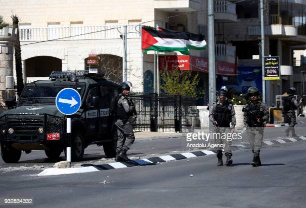 Israeli security forces prepare to intervene in a protest against the US decision to recognize Jerusalem as Israel's capital on the 100th day of its...