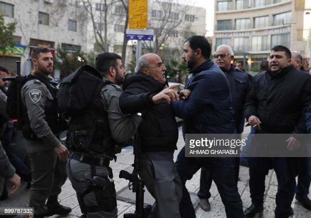 Israeli security forces restrain a Palestinian protester during a small protest in Arab east Jerusalem on December 30 2017 against the US recognition...