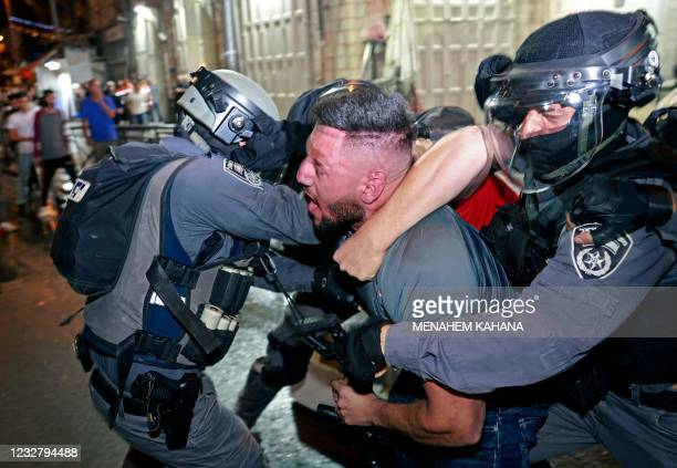 Israeli security forces scuffle with a Palestinian protester outside the Damascus Gate in Jerusalem's Old City on May 9, 2021. - Israel vowed to...