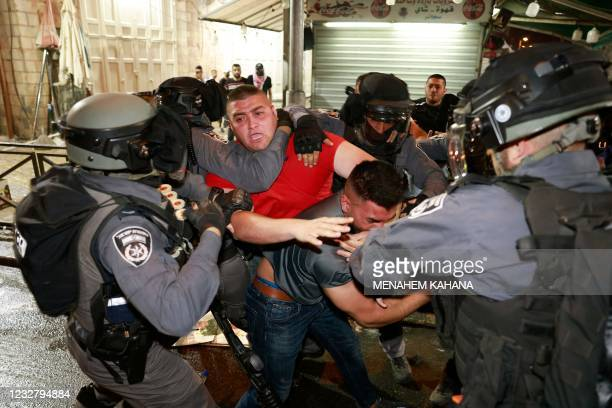 Israeli security forces scuffle with Palestinian protesters outside the Damascus Gate in Jerusalem's Old City on May 9, 2021. - Israel vowed to...