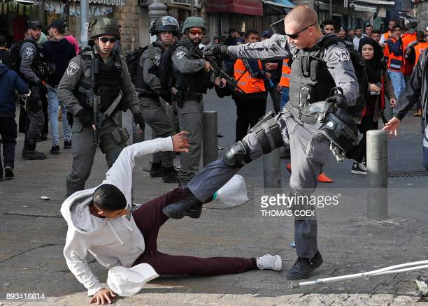 TOPSHOT Israeli security forces scuffle with Palestinian protestors just outside Jerusalem's Old City on December 15 2017 Thousands of Palestinians...