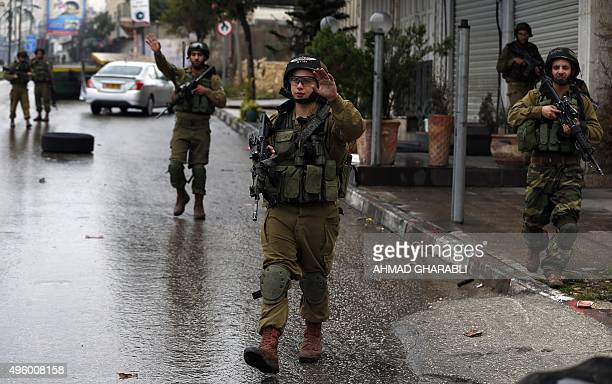 Israeli security forces secure the area where a Palestinian woman was shot after she allegedly attempted to ram Israeli soldiers in the West Bank...