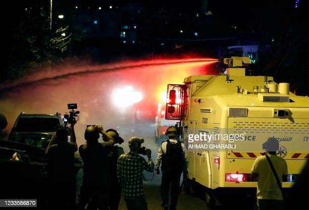 Israeli security forces spray Palestinian protesters with skunk water in the east Jerusalem neighbourhood of Sheikh Jarrah on June 21 during clashes...