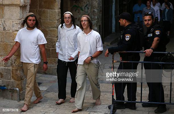 Israeli security forces stand guard as a group of Jewish youths leaves the alAqsa mosque compound in the Old City of Jerusalem on April 25 2016...