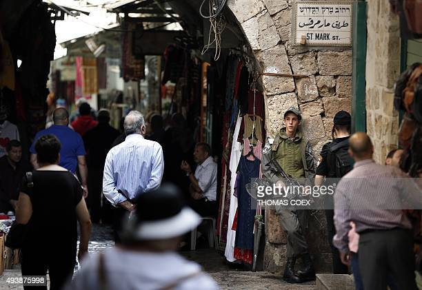 Israeli security forces stand guard in a streets of the Muslim quarter in the Old City of Jerusalem ahead of the Friday prayer on October 23 2015...
