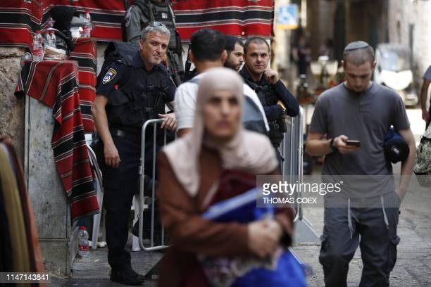Israeli security forces stand guard in one of the alleys of Jerusalem's Old City following a knife attack early on May 31 2019 Two Israelis were...