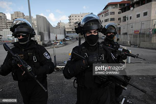 Israeli security forces stand guard in the east Jerusalem Shuafat refugee camp ahead of a planned demolition of a home of a Palestinian who carried...
