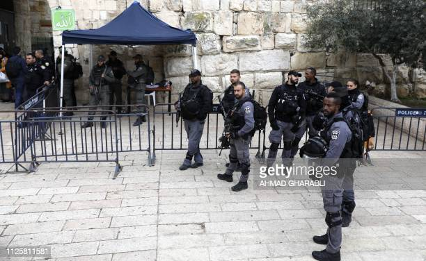 Israeli security forces stand guard inside Lion's Gate which leads to the AlAqsa compound in Jerusalem's Old City on February 19 2019 Israeli police...