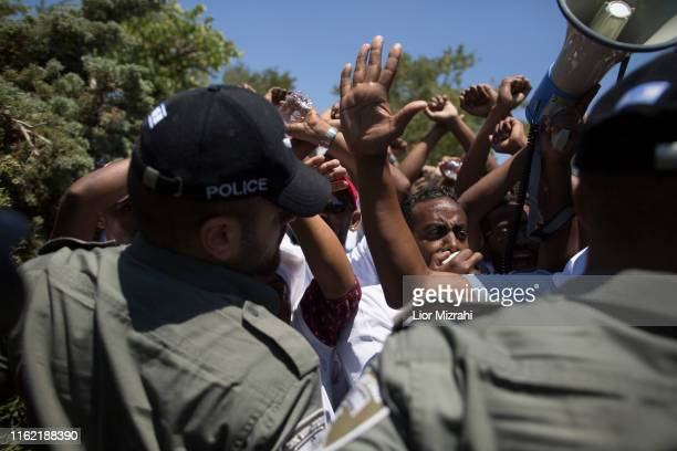 Israeli Security forces surround Israelis of Ethiopian origin as they protest outside the Knesset on July 15 2019 in Jerusalem Israel The protests...