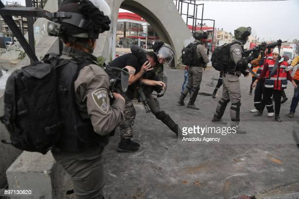 Israeli security forces take a demonstrator into custody during a demonstration against US President Donald Trump's recognition of Jerusalem as...