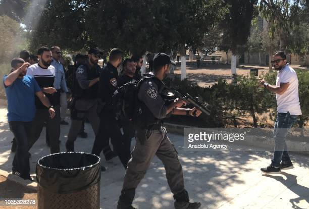 Israeli security forces take a Palestinian into custody as Israeli settlers storm AlAqsa compound in East Jerusalem on September 18 2018